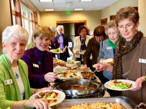 Members enjoy a delicious buffet luncheon at our regular monthly meeting