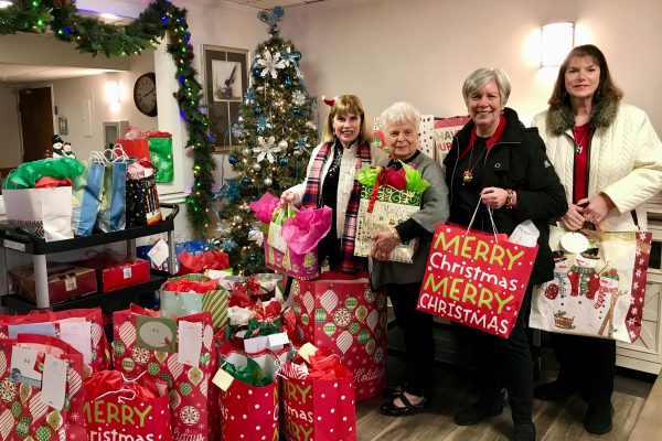 Care Center Support member deliver Christmas gifts