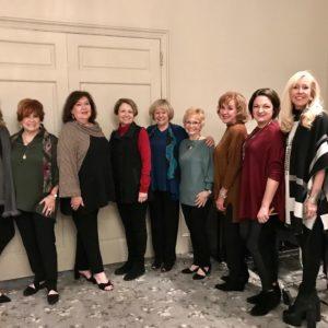 Assistance League of Birmingham women prepare for a fashion show