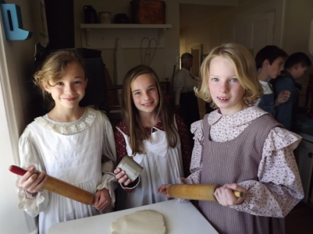 Students try their hands at cooking in an 1890s kitchen