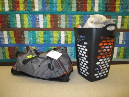 "Empowering Youth ""kit"" with duffel bag and laundry basket stuff full of supplies"
