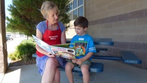 Member reading to child outside of our Philanthropic Center