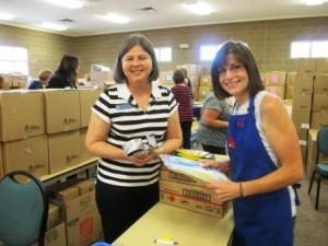 Members assembing school orders at Operation School Supplies
