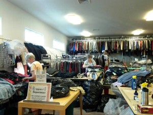 Members processing clothing donations in the Thrift Shop back room
