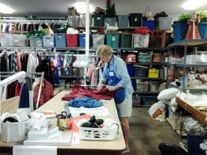 Member processing domestics donations in the Thrift Shop back room