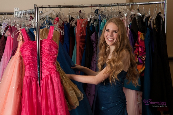 Teen looking through Cinderella's Closet gowns