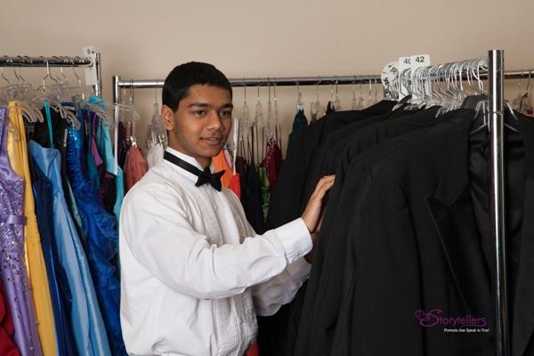 Teen checking out Cinderella's Closet tuxedos