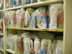 Operation School Bell personal care kits stuffed onto shelves for storage