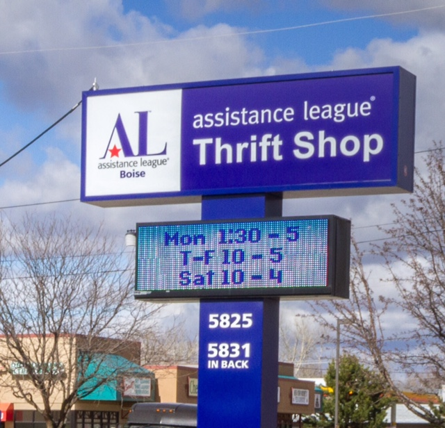 Thrift Shop sign displaying shop hours