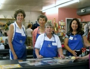 Members working at our Thrift Shop checkout desk