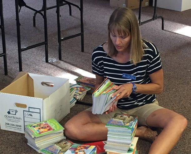 SPARK member preparing books for Operation School Bell