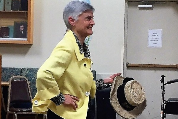 Member showing clothing at Fashion Show