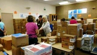 Members assembling school orders at Operation School Supplies