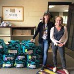 """School staff receiving HY Hope """"indie"""" bags"""