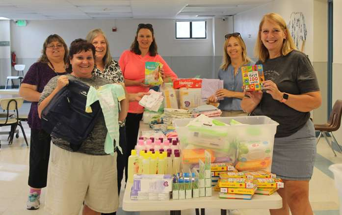 Canyon County Branch members assembling Baby Bundles