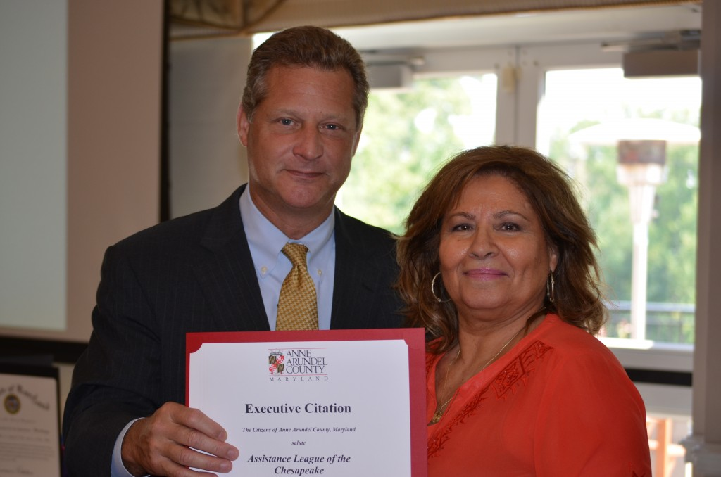 Anne Arundel County Executive Steve Schuh presents a certificate of appreciation to Assistance League of the Chesapeake President Valerie Rees