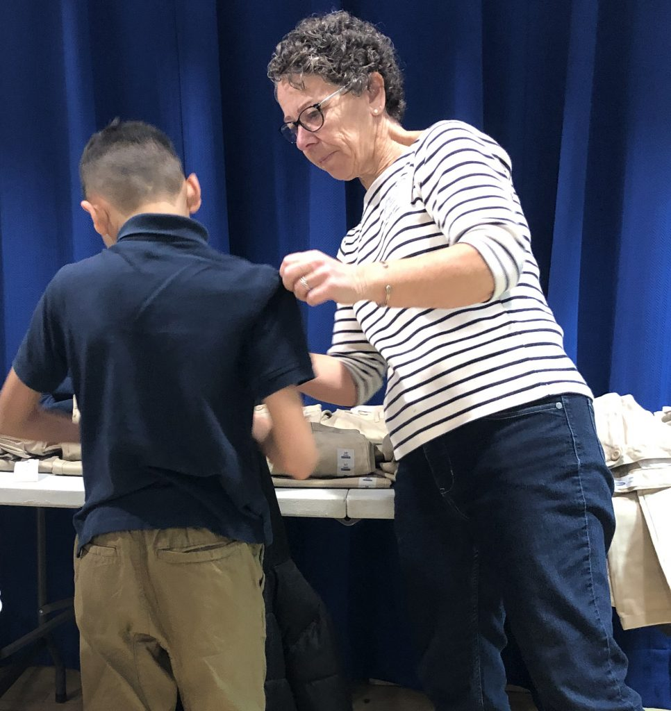 Kids In Need being measured for new uniforms