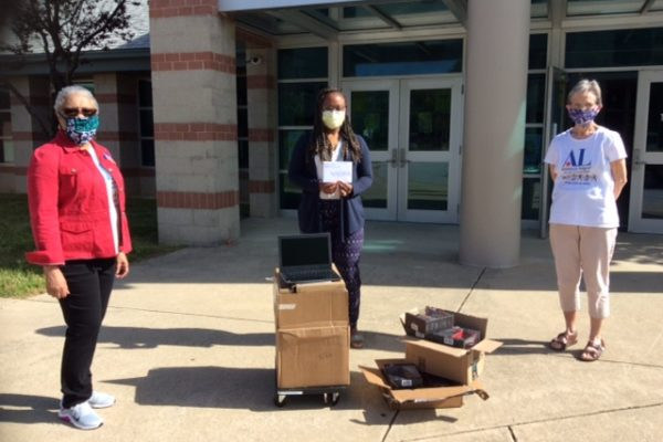 Assistance League members deliver Chromebooks to elementary schools