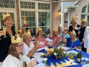 Anniversary luncheon attendees wearing crowns