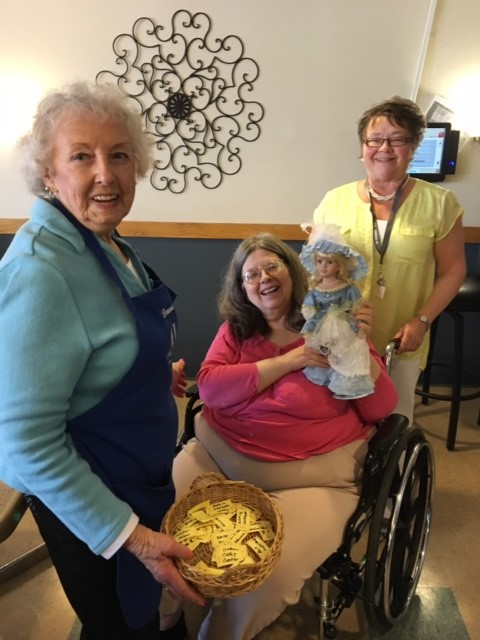 Lady with Doll at Ice Cream Social Cherrelyn Nursing Home