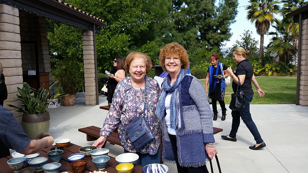 Guests admire handcrafted bowls at 2016 Empy Bowls event