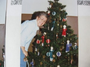 Pat Brudin and one of the many decorated trees at the Gala.