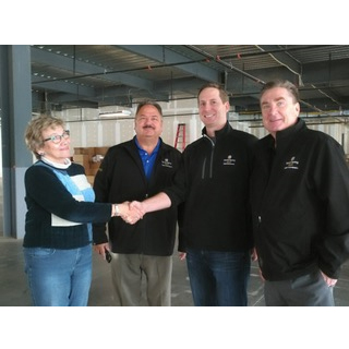 From left: Lynn Barron, Assistance League, Phil Hicks, Adam Dowling, Mike Eastman Sandy Spring Bank )
