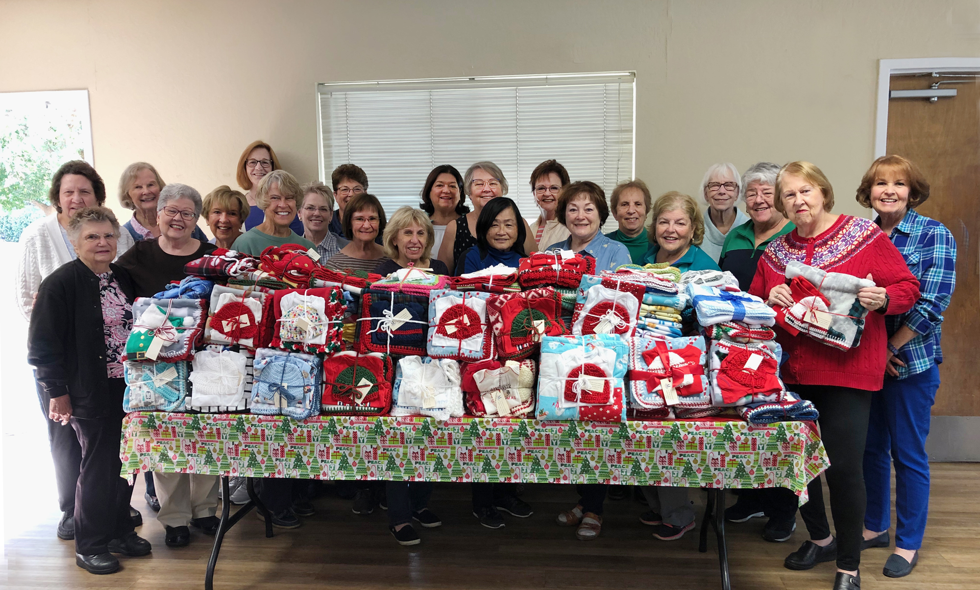 Caring Hands - volunteers with holiday layettes