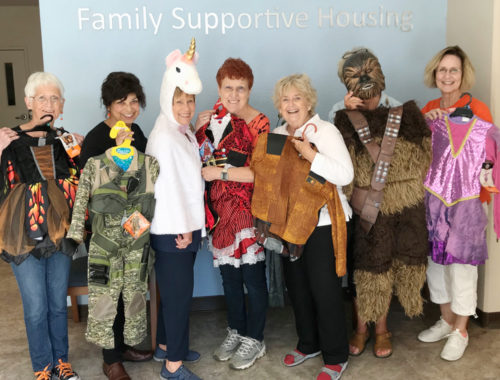 Halloween store at Family Supportive Housing - volunteers with costumes