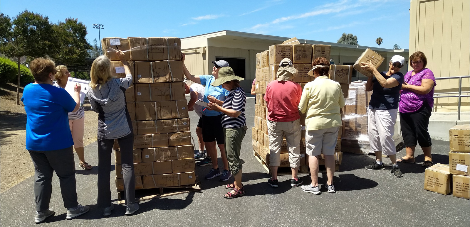 Operation School Bell - unloading pallets of uniforms