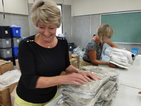 Bagging uniforms for Operation School Bell