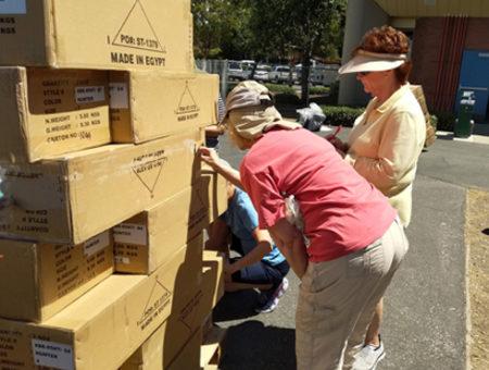 Unloading boxes of uniforms