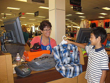 Helping students at a Kohl's Department Store 'shopping event.