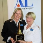 National Operation School Bell award presented to Chris Schroeder Fain (L) by Joan Craig (R) , at Assistance League of Bend's Annual meeting on May 5th, 2015