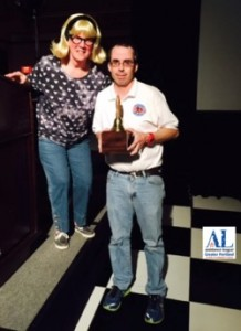 """Robbie O'Brien, VP Resource Development, presenting the award to Jason Zacher at the chapter's 50th Anniversary fundraising party, """"Fifty and Fabulous."""""""