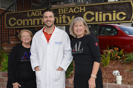 Joining the clinic's Dr. Jorge Rubal are league leaders Gayle Whitaker, left, and Judy Soulakis