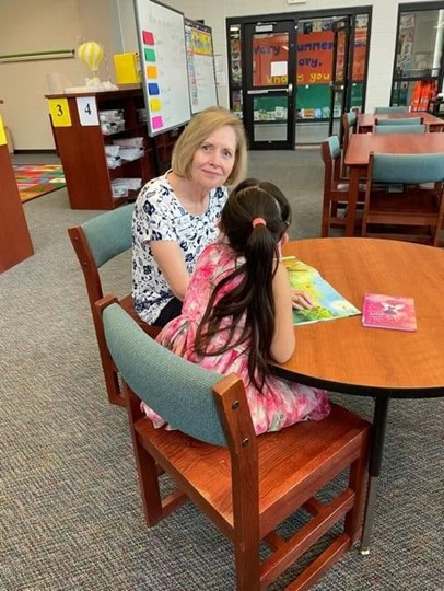 Molly Parkhill with her Reading Buddy