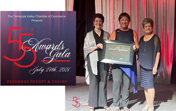 Attending the event and accepting the award on behalf of the membership were President Denise Lanier (ctr); Past Presidents and Community Ambassadors Dorcas Shaktman (l) and Electra Demos (r).