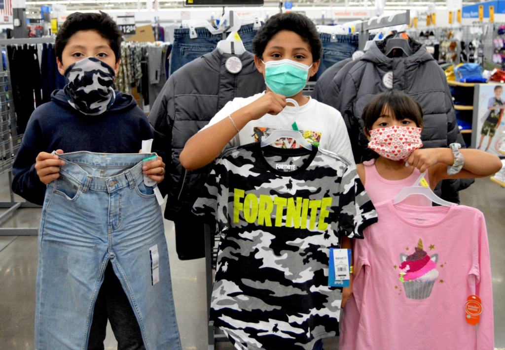 children holding new clothes